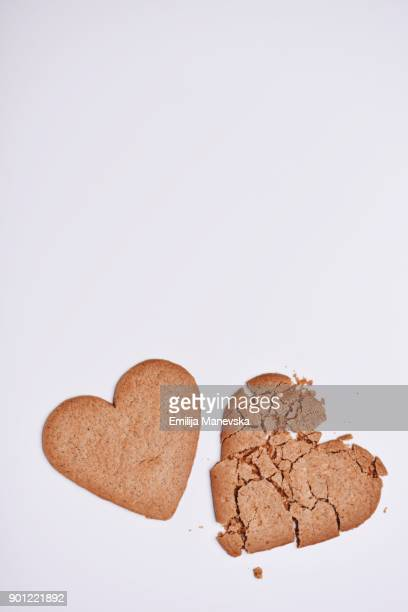 Two Gingerbread heart shaped cookies on white background