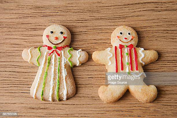 two gingerbread men - gingerbread man stock photos and pictures
