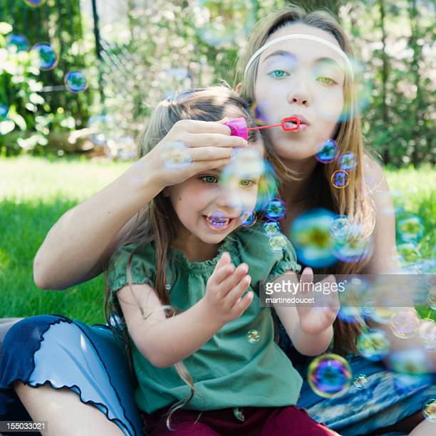 "two gipsy cool kids blowing soap bubbles. - ""martine doucet"" or martinedoucet stock pictures, royalty-free photos & images"