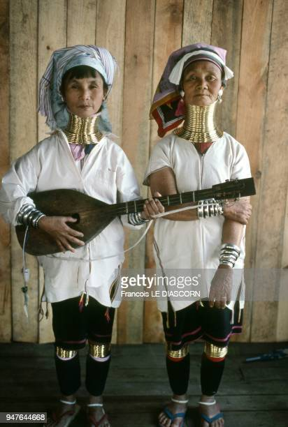 Two Giraffe women from the tribe of the Padaung performing music on the one of the small islands of Inle Lake, 2007 in Myanmar.