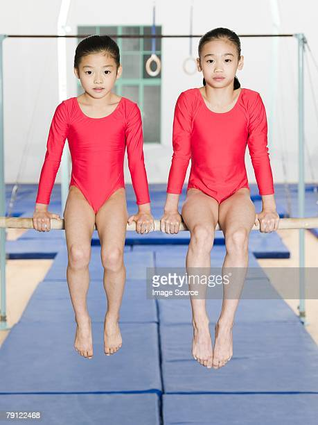Two girl gymnasts