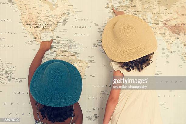 Two girl looking at map