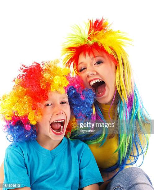 Two girl wearing wigs and screaming.