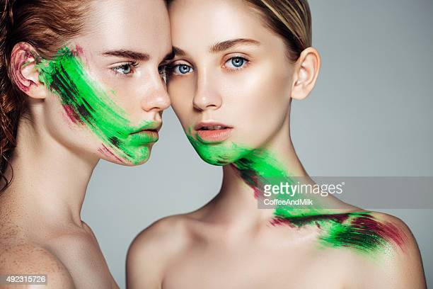 two girl with fantasy makeup - body paint photos stock photos and pictures