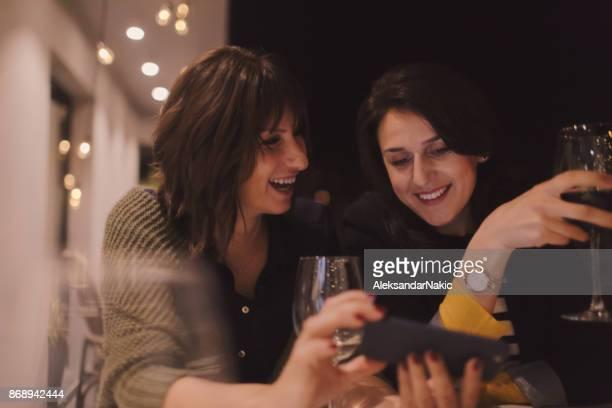 Two girlfriends drinking wine