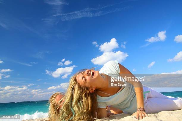 two girlfriends having fun on the beach - nassau stock photos and pictures