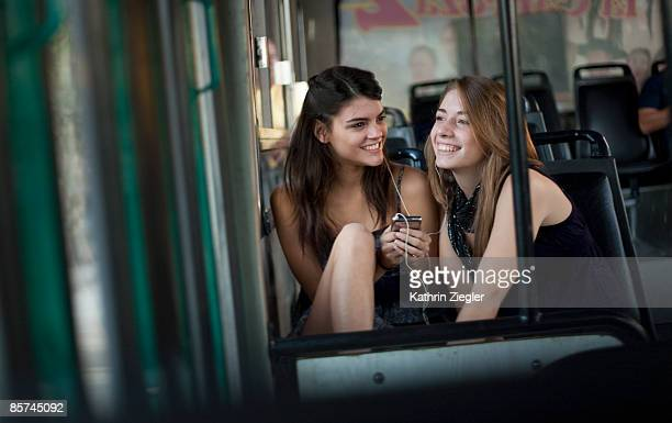 two girlfriends on a bus