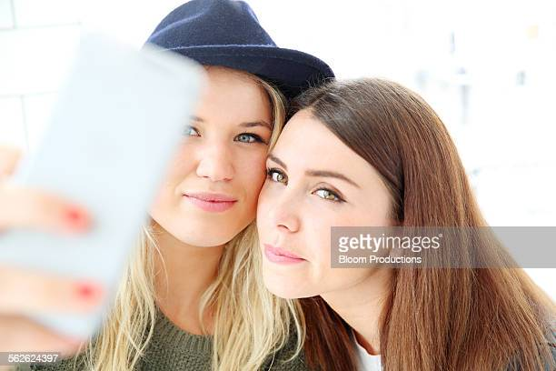 two girlfriends taking a selfie picture - hazel bond stock photos and pictures