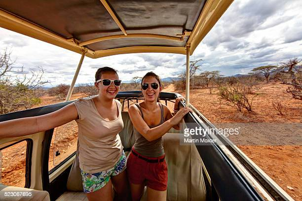two girls, about 13 and 18 years, in a safari bus, samburu national reserve, kenya, east africa, publicground - wildlife reserve stock pictures, royalty-free photos & images