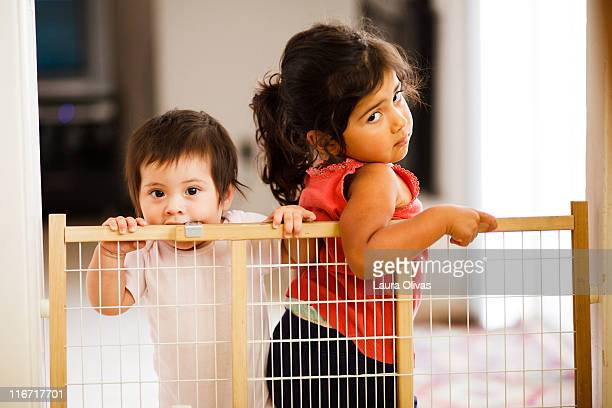 Two girls and a baby gate