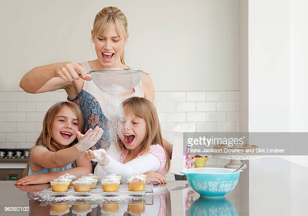 Two girls and a mum baking