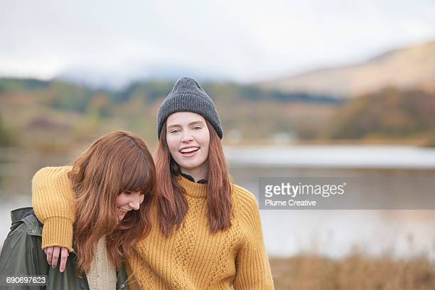 two girls arm in arm - autumn winter fashion collection stock pictures, royalty-free photos & images