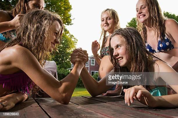 Two girls arm wrestling
