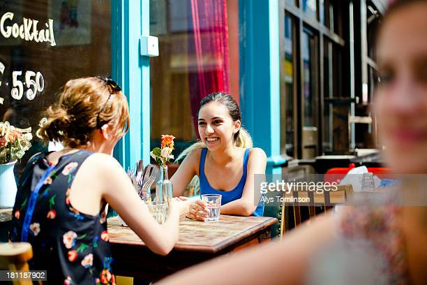 Two girls at a cafe outdoors