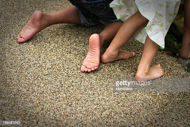 Two girls barefoot