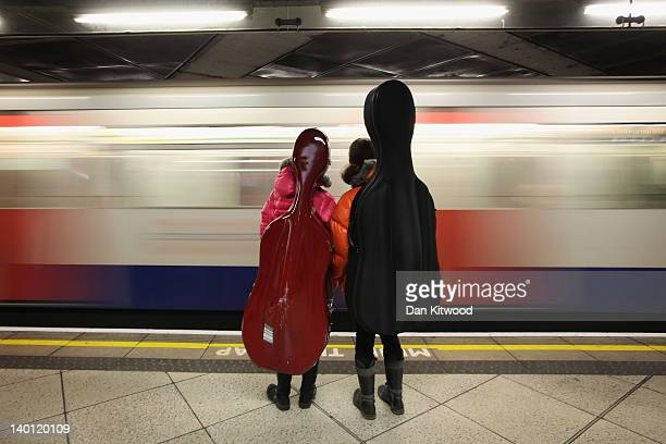 Two girls carrying Cellos wait for a train on London Underground's Westminster Station on February 28 2012 in London England London's Underground...