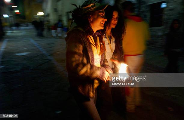 Two girls celebrate the end of the Corsa dei Ceri on May 15 2004 in Gubbio 208 km northeast of Rome Italy Gubbio's Race of the Candles festival dates...