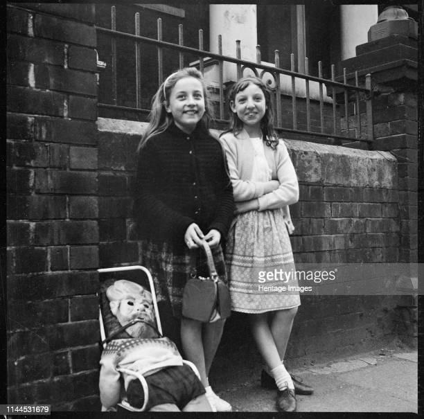 Two girls collecting 'pennies for the guy' outside Hill Top Methodist Church , Westport Road, Burslem, Stoke-on-Trent, 1965-1968. Artist Eileen Deste.