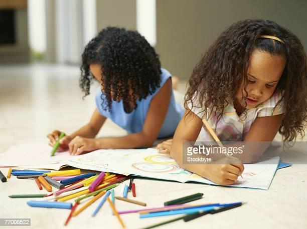 two girls (4-7) colouring with crayons - colouring bildbanksfoton och bilder