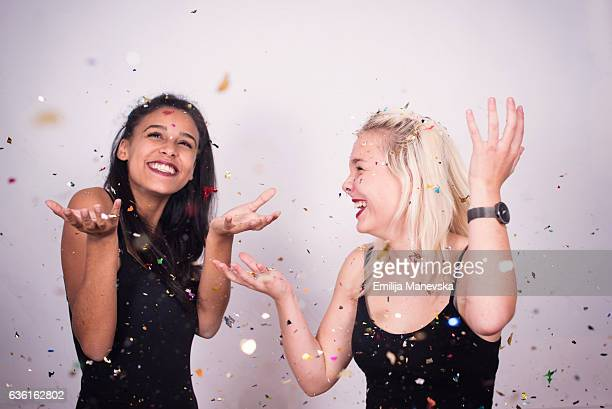 Two girls dancing and smiling