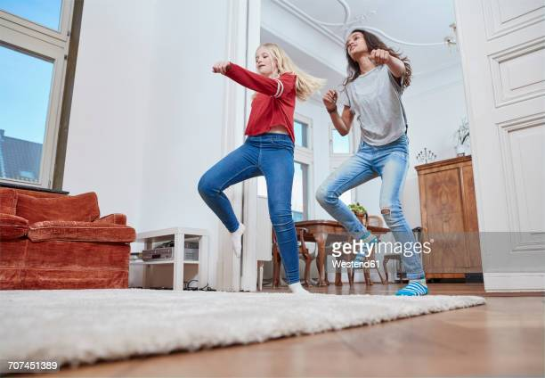 two girls dancing at home - children only stock pictures, royalty-free photos & images