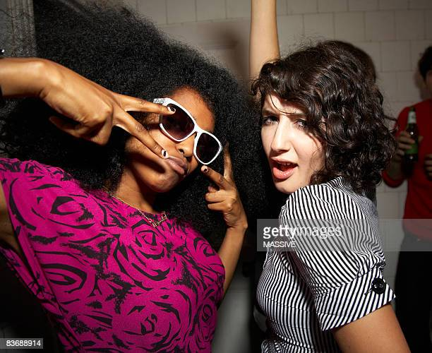 two girls dancing - sunglasses stock pictures, royalty-free photos & images