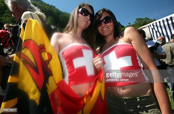 Two girls decorated with Swiss flags attend the Ruetli celebrations on August 1 near Luzern Switzerland Every year the reenactment of the forming of...
