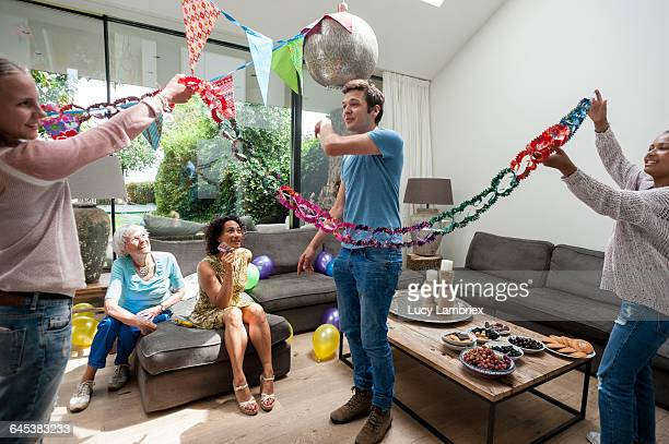 Two girls decorating home for birthday
