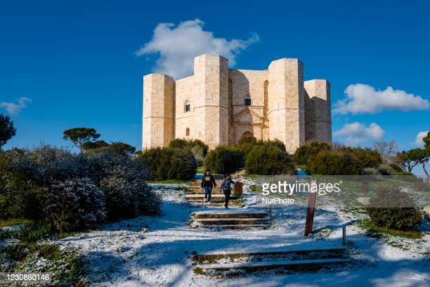 Two girls descend the hill of Castel del Monte covered with snow from the snowfall of the night on January 18, 2021. The cold wave continues in...