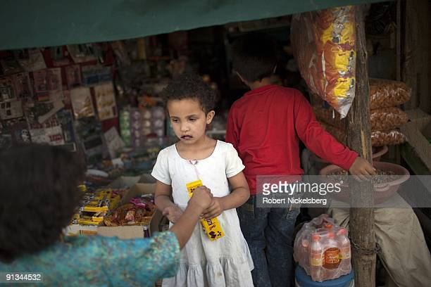 Two girls discuss sharing candy in the Jangalak neighborhood during the month of Ramadan in Kabul Afghanistan August 29 2009