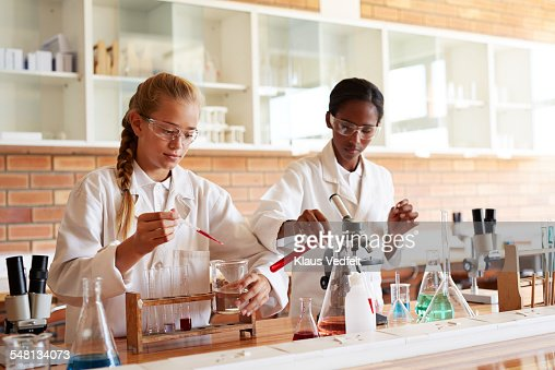 Two girls doing science project in school lab