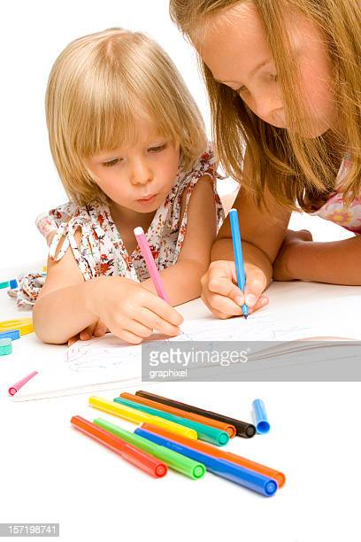 two girls drawing - graphixel stock pictures, royalty-free photos & images
