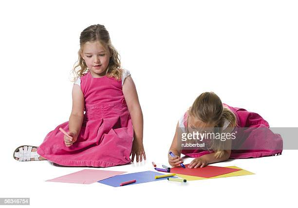 two girls drawing - only girls stock pictures, royalty-free photos & images