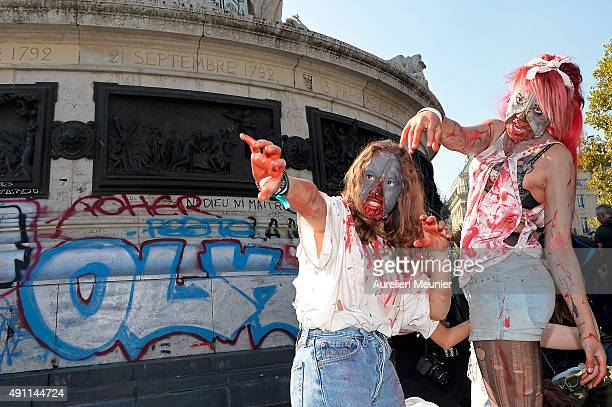 Two girls dressed as a zombies pose on Place de la Republique square during the Paris zombie walk on October 3 2015 in Paris France Hundreds of...