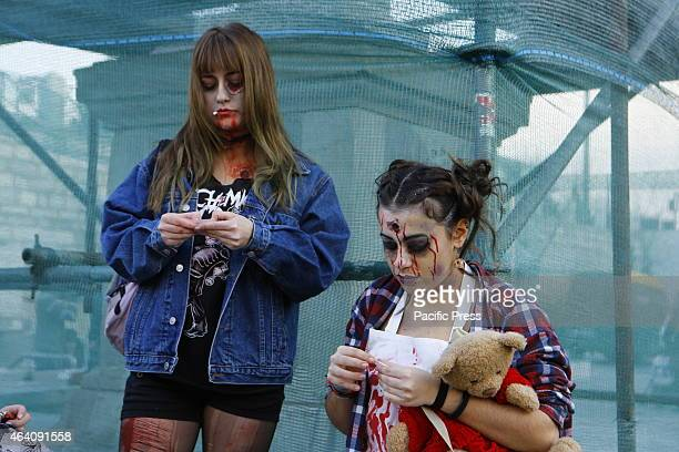 SQUARE ATHENS ATTICA GREECE Two girls dressed as zombies People dressed as zombies with makeup and fake blood walked through Athens