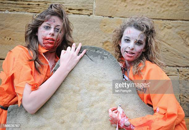 Two girls dressed as zombies pose for the camera at the Goth weekend on November 2 2013 in Whitby England The Whitby Gothic Weekend that takes place...