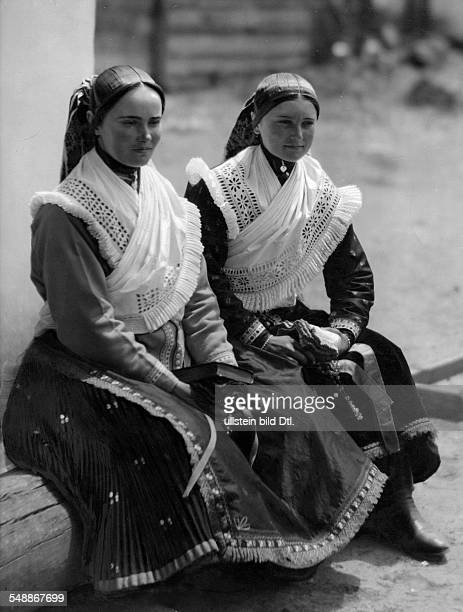 Two girls dressed in traditional costumes - ca. 1929 - Photographer: Rudolf Balogh - Published by: 'Blatt Wien' 20/1929 Vintage property of ullstein...