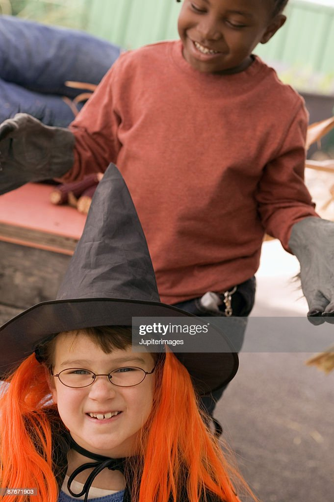two girls dressing up in halloween costumes stock photo