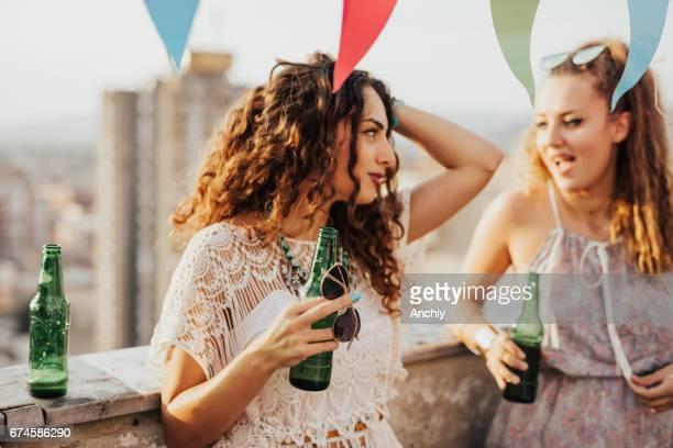 Two girls drinking bottled beer