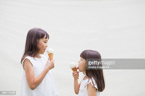 Two Girls Eating Ice Creams