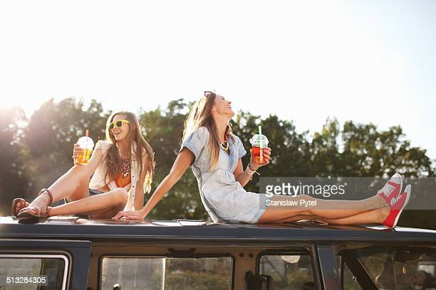 two girls enjoying bubble tea - oben stock-fotos und bilder