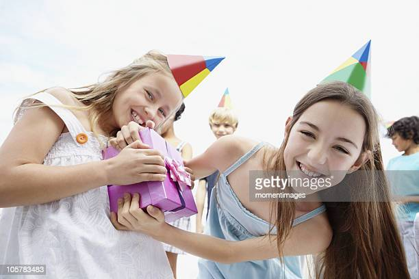 Two girls fighting over birthday present