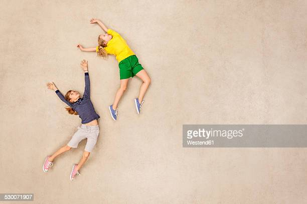 Two girls flying