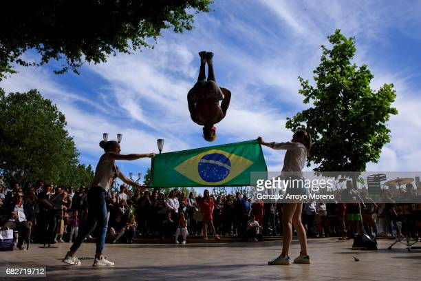 Two girls form the audience hold a Brazilian flag during a capoeira show the day before of the Ironman 703 Pays d'Aix on May 13 2017 in AixenProvence...