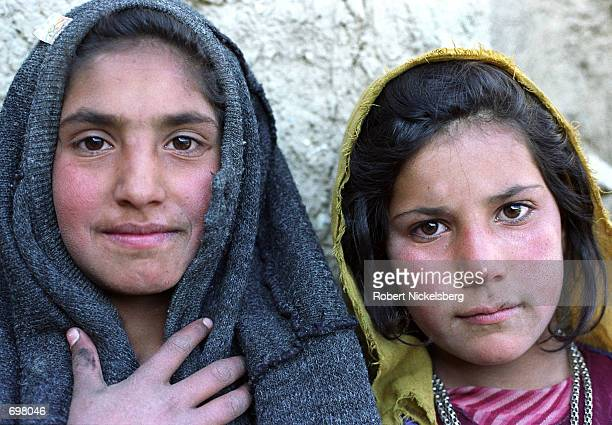 Two girls from farming families from Shomali plains area pose for a photograph November 25 2001 in Karabagh Afghanistan Their farms 30 miles north of...