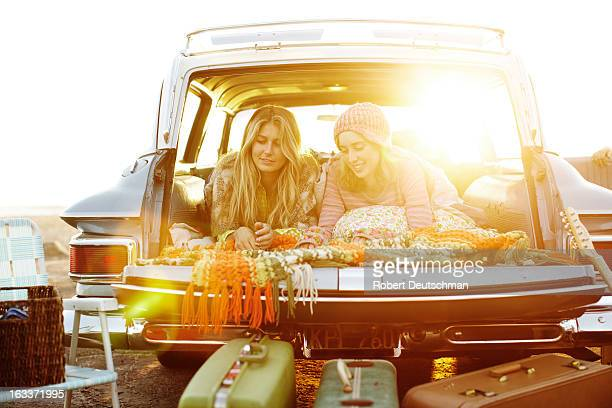 Two girls hanging out in a car.