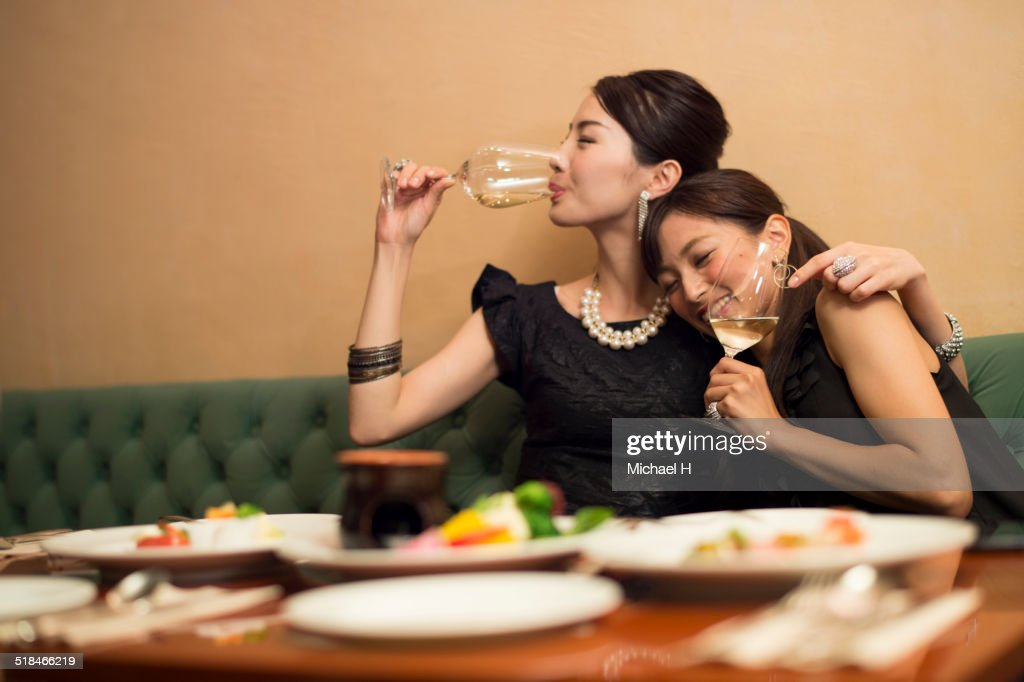 Two girls having fun in party atmosphere. : Stock Photo