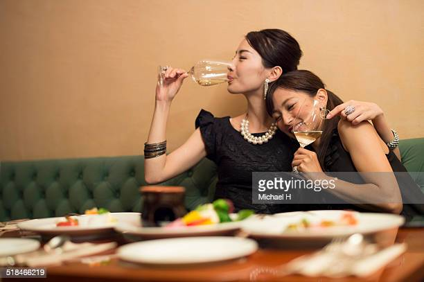 Two girls having fun in party atmosphere.