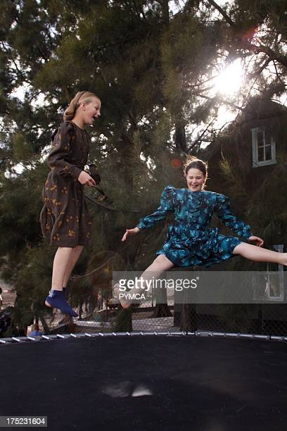 Two girls having fun on a trampoline Amish community in Mexico 2009