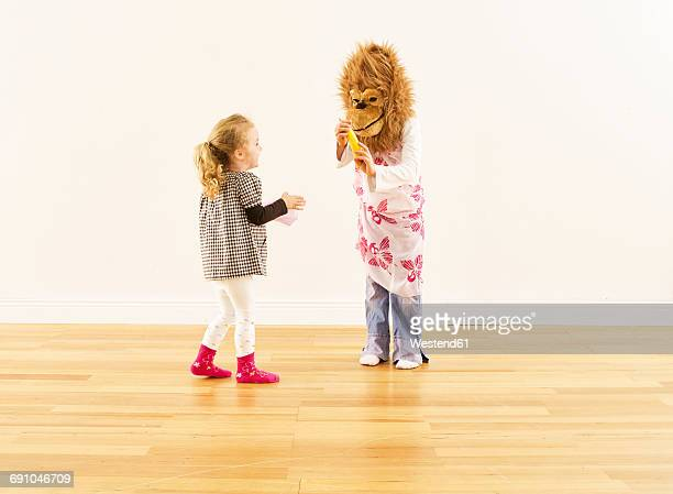 two girls having fun with monkey mask - monkey suit stock pictures, royalty-free photos & images